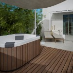 Garden with hot tub, sunloungers and seating area